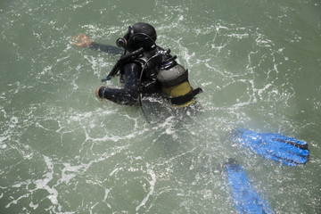 Commercial diver entering the sea
