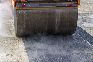 Detail of road roller during asphalt patching works 2