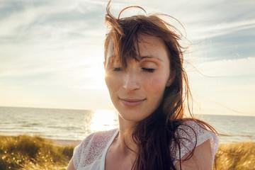 carefree female portrait coast sunset