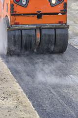 Detail of road roller during asphalt patching works 3