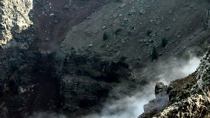 A fragment of the volcano crater, from several points of smokes