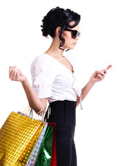 Woman with shopping bags and mobile phone.