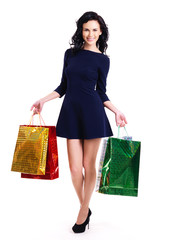 Portrait of happy woman with shopping bags.