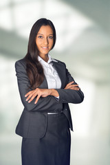Stylish hostess or businesswoman standing waiting