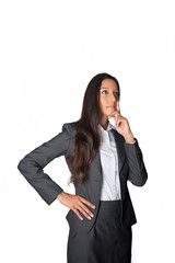 Pensive businesswoman staring into the air