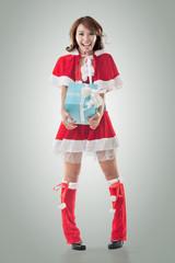 Christmas girl hold gift box