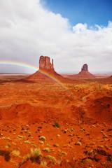 Red stone desert and rainbow