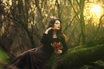 Romantic brunette posing in a mystical forest