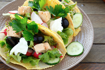 Mexican tacos with fish and vegetables