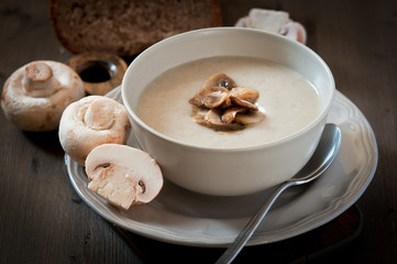 Mushroom cream soup on a wooden background