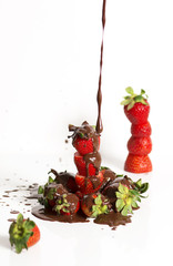 A group of fresh strawberries and dark chocolate with a white ba