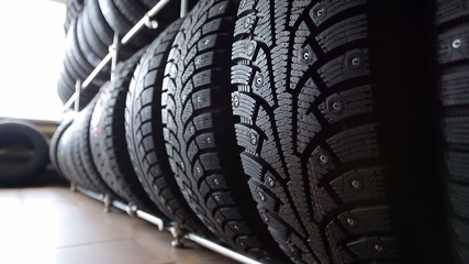 Large stand with wheel tires in an auto parts store