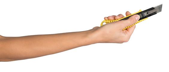 Female hand holding cutter knife