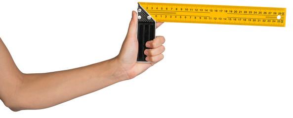 Female hand holding angle ruler