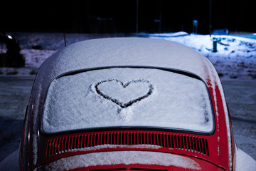 Heart drawn on a snowy rear windshield