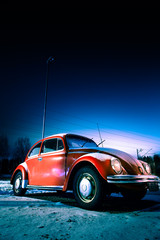 Red car at night in the winter