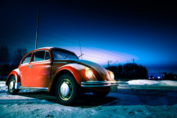Red car in a winter night