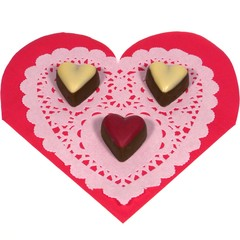 Hearts of chocolate on a red heart with lace paper