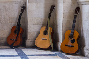Three guitars against the wall in Greece