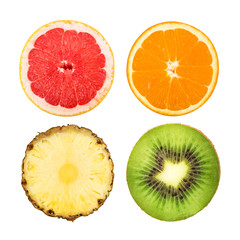 Slices of grapefruit, orange, pineapple and kiwi