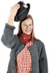 Frau aus Bayern grüßt mit Hut