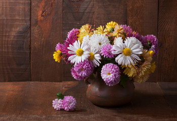 Still life with colourful chrysanthemums bunch  on wooden table