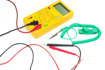 Yellow digital clamp meter and antistatic wrist strap