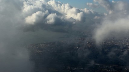View of the seaside town through the clouds