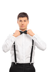 Confident young man adjusting his bow-tie