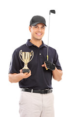 Male golfing champion holding a gold cup
