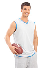 Young male football player holding a ball
