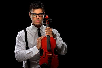 Young musician posing with a violin