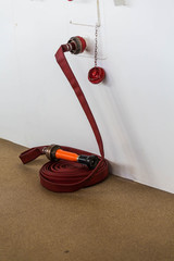 Red Fire Hose by White Bulkhead