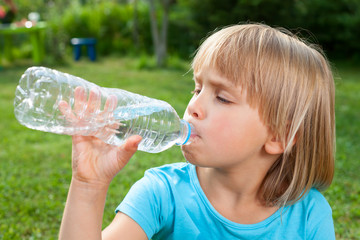 Child drinking water outdoor