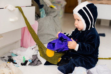 child throws clothes
