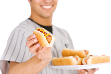 Baseball: Player Holding Plate of Hot Dogs