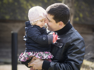 Father and daughter outdoors in Autumn
