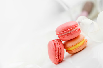 Colorful French pastry on a white background.