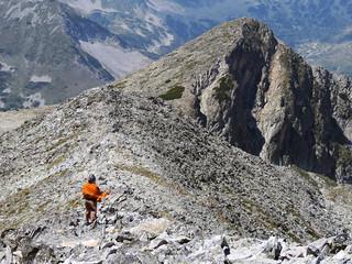 Single Woman High On A Rocky Mountain