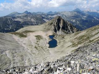 Lady With Bun - High Mountain Lake In Pirin Mountain, Europe