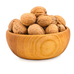 Wooden bowl full of walnuts