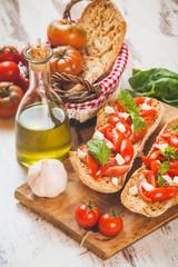 Italian starter, bruschetta with Sicilian red fresh tomato and m