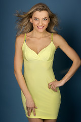 smiling girl in yellow dress posing