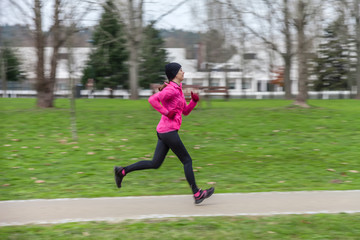 Young woman running on a cold winter day