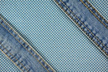 Jeans with stitch on blue dot cloth background