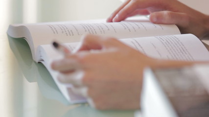 Male (hands) reading a book, closeup