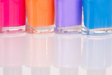 Four multi-colored nail polish