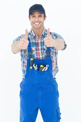 Confident plumber showing thumbs up sign