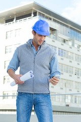 Architect reading text message thought mobile phone