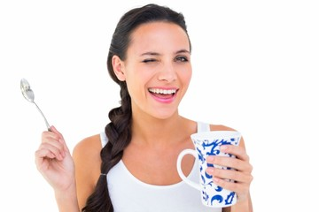 Pretty brunette having cup of tea